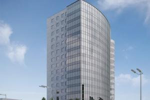 Многоэтажное административное здание с помещениями для торговли в квартале пр. Дзержинского-ул. Уманской-ул.Железнодорожной